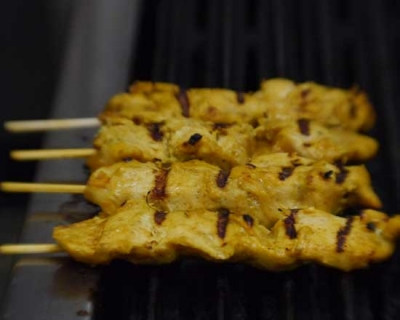 an image of our chicken satay sticks on the bbq