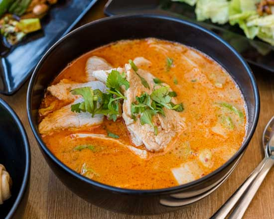 an image of our tom kha chicken soup
